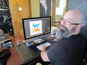 Designer Constructs Brand Logo