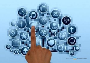 a photo of a hand pointing at various social media icons