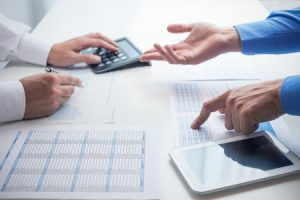 Local SEO Consultant & Plumber Discussing Data