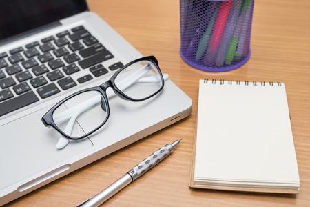 Pen, Notepad, Laptop, Each Representing Qualities Of Plumber Advertising in 2017